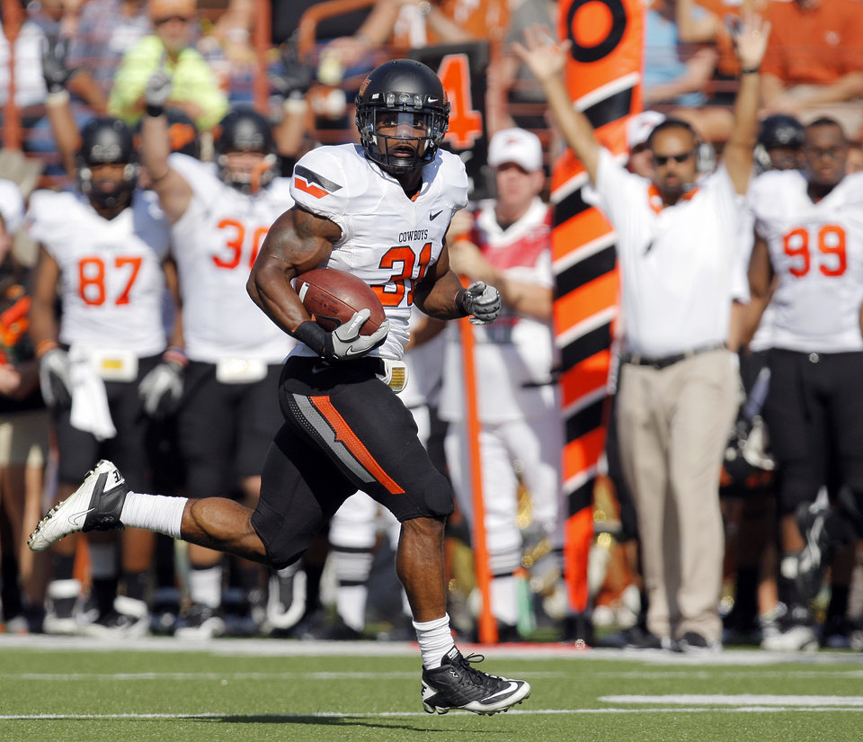 Photo - Oklahoma State's Jeremy Smith (31) rushes for a touchdown in the second quarter during a college football game between the Oklahoma State University Cowboys (OSU) and the University of Texas Longhorns (UT) at Darrell K Royal-Texas Memorial Stadium in Austin, Texas, Saturday, Oct. 15, 2011. Photo by Nate Billings, The Oklahoman