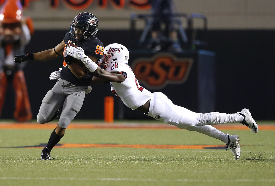 Photo - Oklahoma State's Landon Wolf (88) tries to get by South Alabama's Travis Reed (28) during a college football game between Oklahoma State (OSU) and South Alabama at Boone Pickens Stadium in Stillwater, Okla., Saturday, Sept. 8, 2018. Photo by Sarah Phipps, The Oklahoman