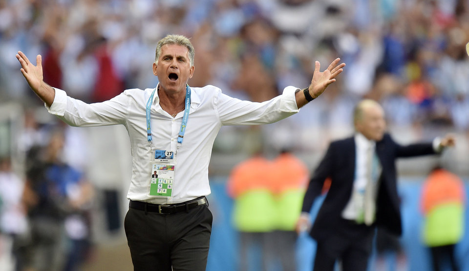 Photo - Iran's head coach Carlos Queiroz questions a call during the group F World Cup soccer match between Argentina and Iran at the Mineirao Stadium in Belo Horizonte, Brazil, Saturday, June 21, 2014. Argentina defeated Iran 1-0. (AP Photo/Martin Meissner)