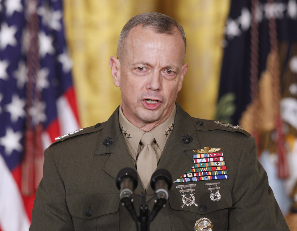 Photo -   FILE -- In an April 28, 2011 file photo Marine Corps Lt. Gen. John Allen, speaks in the East Room of the White House in Washington. The sex scandal that led to CIA Director David Petraeus' downfall widened Tuesday with word the top U.S. commander in Afghanistan is under investigation for thousands of alleged