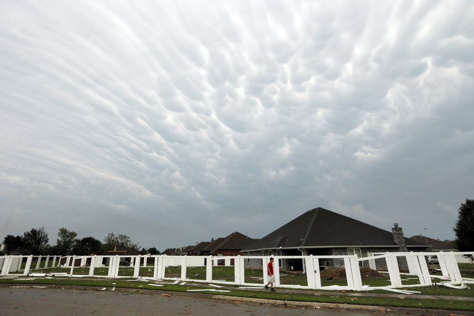 Photo -  Clouds over the Stone Meadow neighborhood south of SW 149 between Western and Hudson May 20 after a tornado struck south Oklahoma City and Moore. Photo by Nate Billings, The Oklahoman   NATE BILLINGS -  NATE BILLINGS