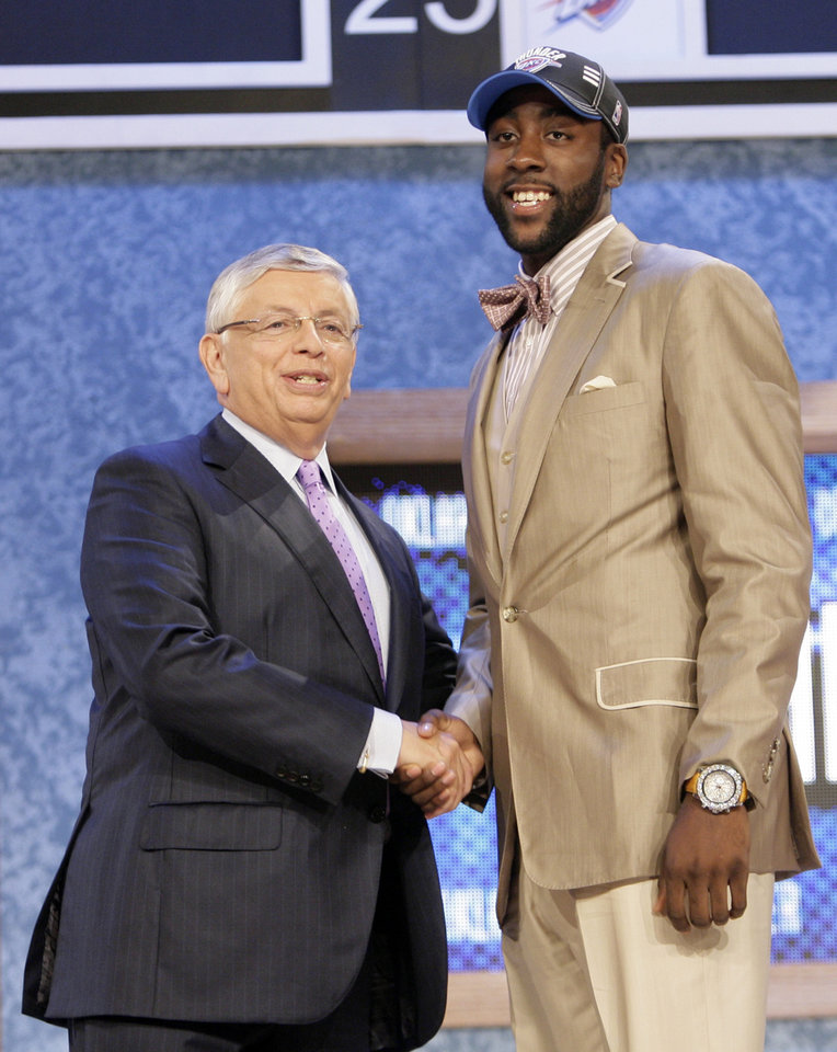 Photo - NBA commissioner David Stern, left, poses with Arizona State University's James Harden, who was selected by the Oklahoma City Thunder during the first round of the NBA basketball draft, Thursday, June 25, 2009, in New York. (AP Photo/Seth Wenig) ORG XMIT: NYFF112