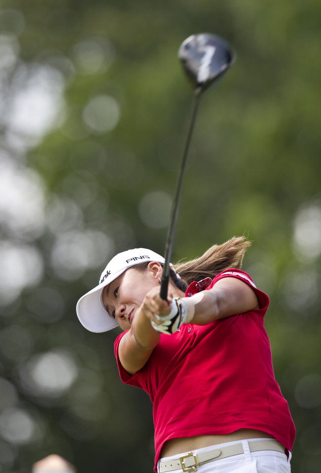 Photo - I.K. Kim, of South Korea, hits off the 10th tee box during the final round of the LPGA NW Arkansas Championship golf tournament on Sunday, June 23, 2013, in Rogers, Ark. (AP Photo/Beth Hall)