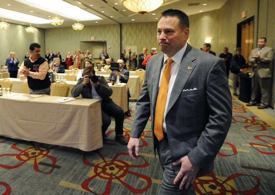 Photo - University of Tennessee head football coach Butch Jones is introduced before speaking at a legislative planning session sponsored by The Associated Press and the Tennessee Press Association on Thursday, Feb. 6, 2014, in Nashville, Tenn. Jones was the recipient of the Tennessee Press association Headliner of the Year Award. (AP Photo/Mark Zaleski)
