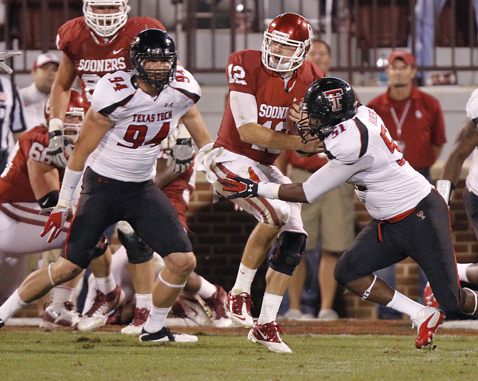 Photo - Texas Tech's Scott Smith (94) and Cqulin Hubert (51) stop Oklahoma's Landry Jones (12) near the goal line during the college football game between the University of Oklahoma Sooners (OU) and Texas Tech University Red Raiders (TTU) at the Gaylord Family-Oklahoma Memorial Stadium on Saturday, Oct. 22, 2011. in Norman, Okla. Photo by Chris Landsberger, The Oklahoman