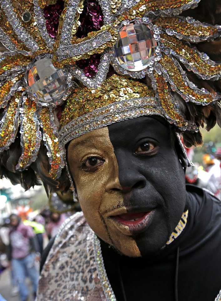 Photo - Members of the Krewe of Zulu march during Mardi Gras day in New Orleans, Tuesday, March 4, 2014. The Zulu parade began on schedule, led by a New Orleans police vanguard on horseback that included Mayor Mitch Landrieu. (AP Photo/Gerald Herbert)