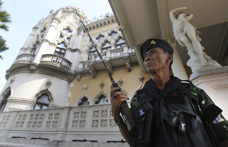 Photo - A Thai soldier guards outside Government House compound of prime minister's office,in Bangkok, Thailand, Tuesday, May 20, 2014. Thailand's army declared martial law before dawn Tuesday in a surprise announcement it said was aimed at keeping the country stable after six months of turbulent political unrest. The military, however, insisted a coup d'etat was not underway. (AP Photo/Sakchai Lalit)