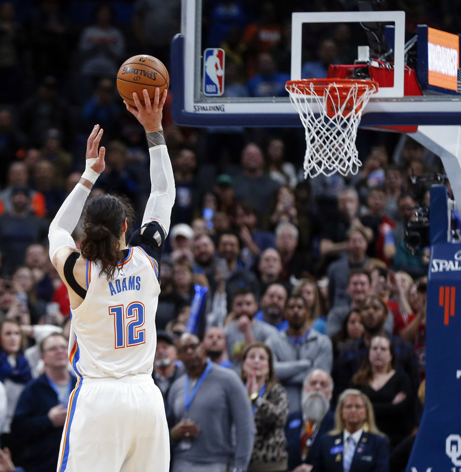 Photo - Oklahoma City's Steven Adams (12) shoots his second free throw with 4.3 seconds left during an NBA basketball game between the Oklahoma City Thunder and Chicago Bulls at Chesapeake Energy Arena in Oklahoma City, Monday, Dec. 16, 2019. Oklahoma City won 109-106. [Nate Billings/The Oklahoman]