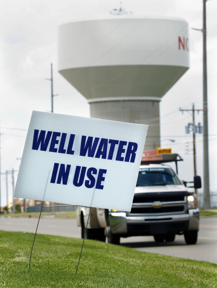 Photo -  A sign posted in west Norman tells residents well water is being used for irrigation purposes.  The Oklahoman Archives   STEVE SISNEY -