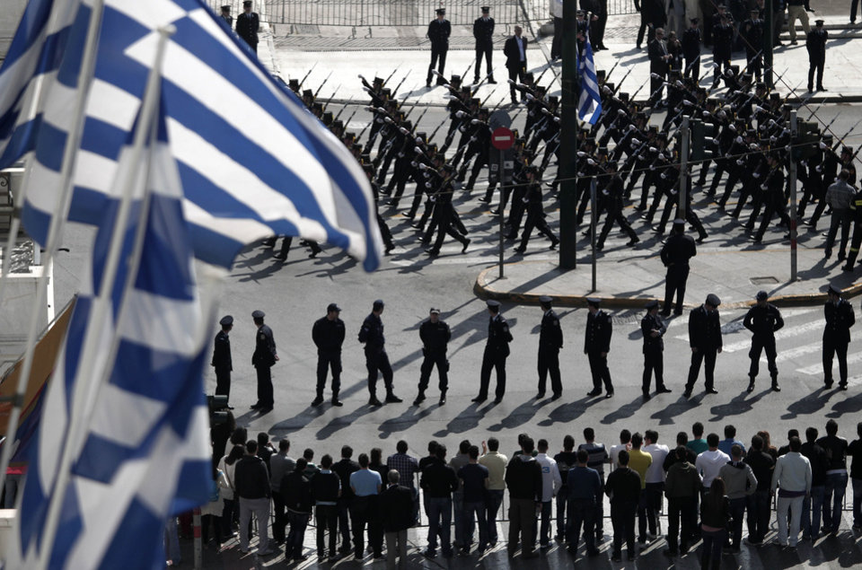 CORRECTS OBJECT NAME Greek Army cadets parade with the presence of only officials and police officers, without spectators in Athens on Sunday March 25, 2012. Greek authorities have launched a massive security operation across central Athens for a military parade in the capital to mark the country's independence day, for fear that anti-austerity protests could disrupt the march. Thousands of police have been mobilized, while traffic on all major routes leading to the parade area has been blocked off. For the first time, the public will be banned from a large part of the route, including the area in front of Parliament from where politicians and other officials will watch the march. (AP Photo/Dimitri Messinis)