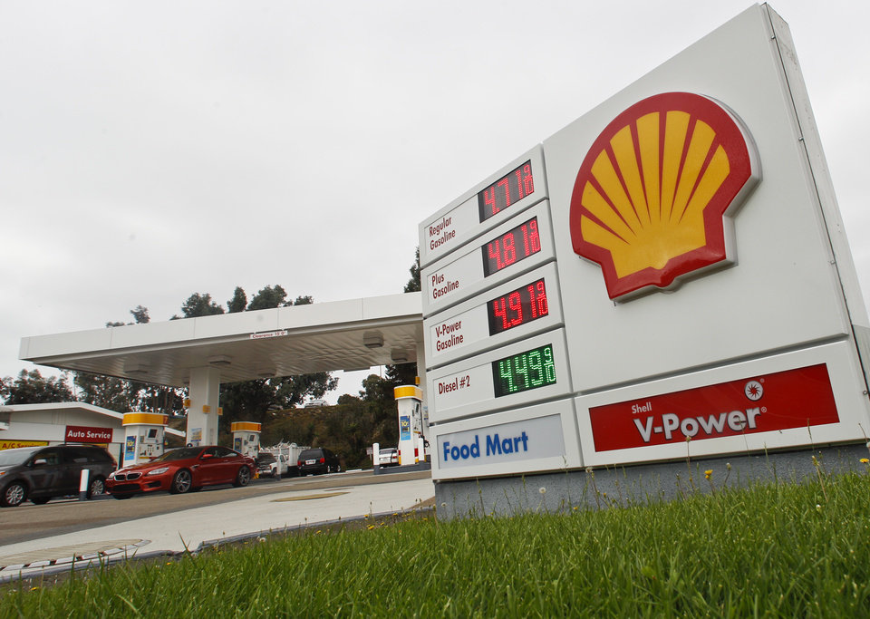 Photo -   Gas prices approach $5.00 a gallon at a Shell Station Monday, Oct. 8, 2012 in Encinitas, Calif. Gas prices across California have risen dramatically in the past week. (AP Photo/Lenny Ignelzi)