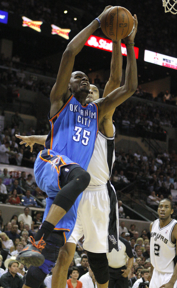Oklahoma City\'s Kevin Durant (35) goes to the basket in front of San Antonio\'s Tim Duncan (21) during Game 2 of the Western Conference Finals between the Oklahoma City Thunder and the San Antonio Spurs in the NBA playoffs at the AT&T Center in San Antonio, Texas, Tuesday, May 29, 2012. Photo by Bryan Terry, The Oklahoman