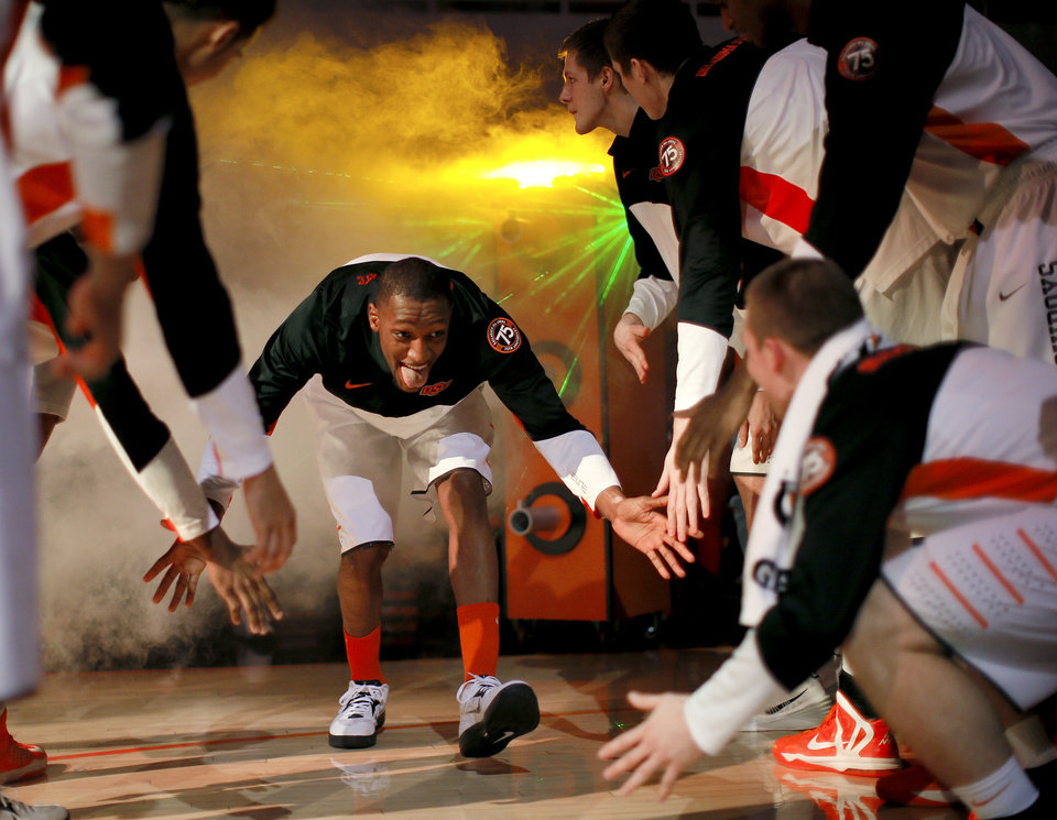 Photo - Oklahoma State's Kamari Murphy is introduced before an NCAA college basketball game between Oklahoma State University (OSU) and TCU at Gallagher-Iba Arena in Stillwater, Okla., Wednesday, Jan. 15, 2014. Oklahoma State won 82-50. Photo by Bryan Terry, The Oklahoman