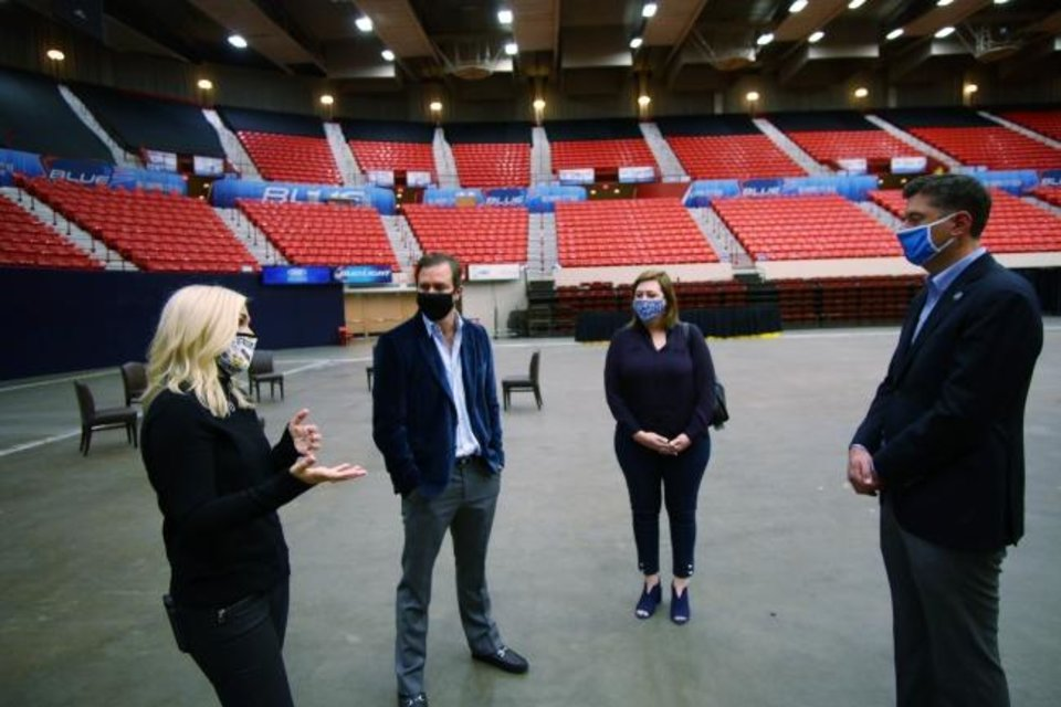 Photo -  Rachel Cannon and Matt Payne, founders of Prairie Surf Media, discuss plans for  converting the Cox Convention Center into a film studio with Assistant City Manager  Aubrey McDermid and Mayor David Holt. [DOUG HOKE/THE OKLAHOMAN]