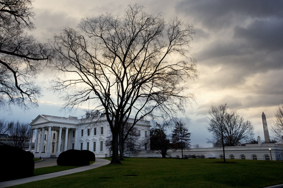 "Photo - Clouds roil over the White House in Washington on the morning of Sunday, Dec. 30, 2012, as Washington has less than 48 hours to avert the ""fiscal cliff,"" a series of tax increases and spending cuts set to take hold on Jan. 1. Republican and Democratic negotiators in the Senate were hoping to reach a deal to avoid going over the cliff on Sunday. (AP Photo/Jacquelyn Martin)"