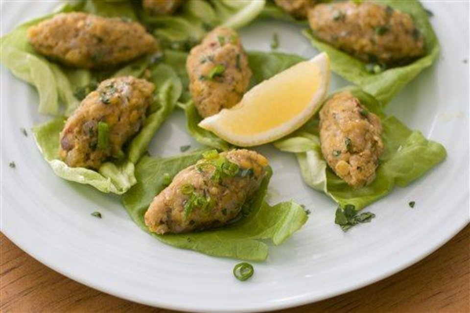 Photo - This image taken on Jan. 30, 2012 in Concord, N.H., shows vegetarian Turkish red lentil balls, a delicious, healthy and easy way to include a taste of Persian cuisine in your own Purim feast. (AP Photo/Matthew Mead)
