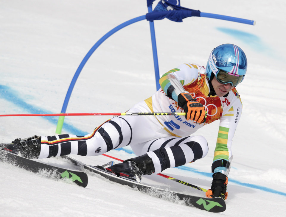 Photo - Germany's Felix Neureuther passes a gate in the first run of the men's giant slalom at the Sochi 2014 Winter Olympics, Wednesday, Feb. 19, 2014, in Krasnaya Polyana, Russia. (AP Photo/Charles Krupa)