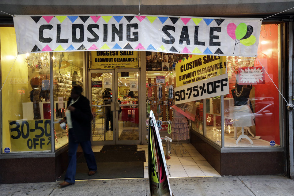 """In this Tuesday, Dec. 18, 2012 photo, a person exits a business with a """"Closing Sale"""" sign, in Philadelphia. Confidence among U.S. consumers has sunk to its lowest point since July, according to a monthly index released Friday, Dec. 21, 2012. The University of Michigan says its consumer sentiment index for December fell to 72.9, a sharp drop from the November reading of 82.7. The November figure was a five-year high. (AP Photo/Matt Rourke)"""