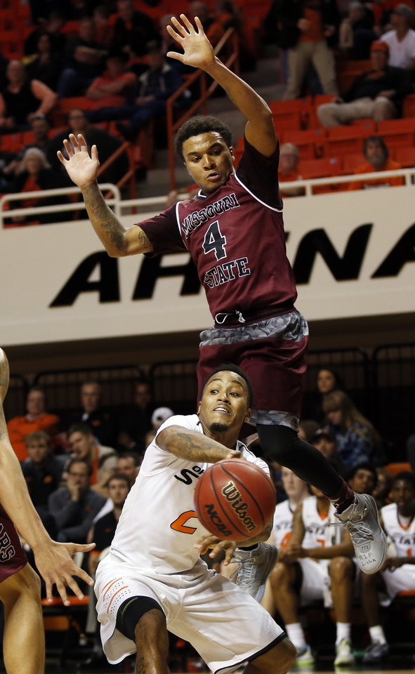 Photo - OSU's Tyree Griffin (2) passes underneath Missouri State's Dequon Miller (4) during a men's college basketball game between Oklahoma State and Missouri State at Gallagher-Iba Arena in Stillwater, Okla., Saturday, Dec. 5, 2015. Missouri State won 64-63. Photo by Nate Billings, The Oklahoman