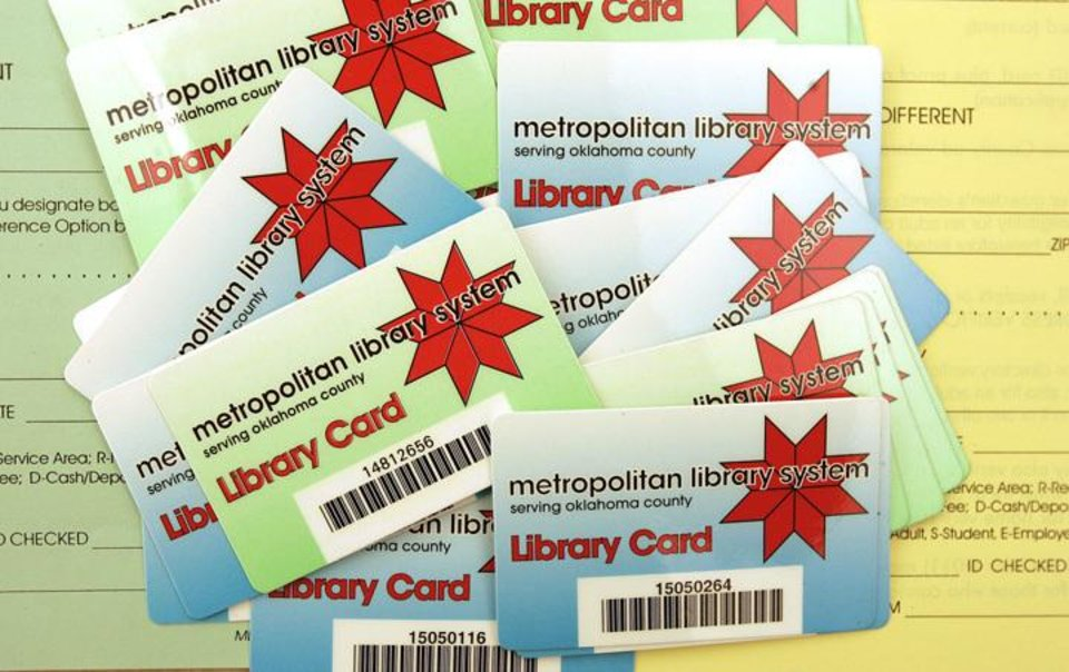Photo - OKLAHOMA CITY,OK., Friday, Nov. 19, 2004.     METROPOLITAN LIBRARY SYSTEM / CARD: New library cards at the Ronald J. Norick Downtown Library, 300 Park Avenue. Staff photo by Jaconna Aguirre.