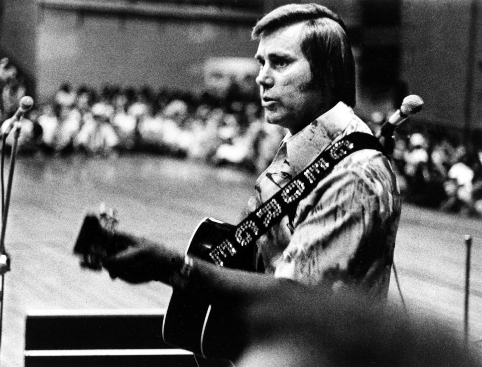 Photo - FILE - In this undated photo, Country singer George Jones is shown performing with his guitar.  Jones, the peerless, hard-living country singer who recorded dozens of hits about good times and regrets and peaked with the heartbreaking classic