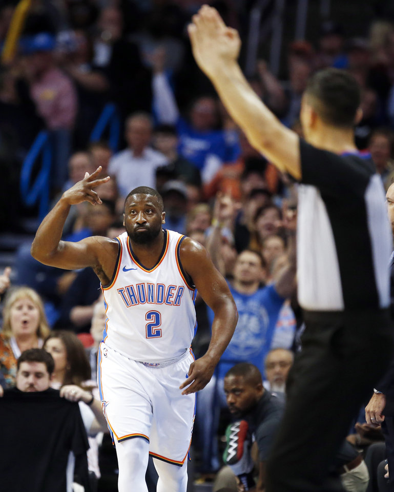 Photo - Oklahoma City's Raymond Felton (2) reacts after a three-point shot during an NBA basketball game between the Oklahoma City Thunder and the Orlando Magic at Chesapeake Energy Arena in Oklahoma City, Monday, Feb. 26, 2018. Oklahoma City won 112-105. Photo by Nate Billings, The Oklahoman