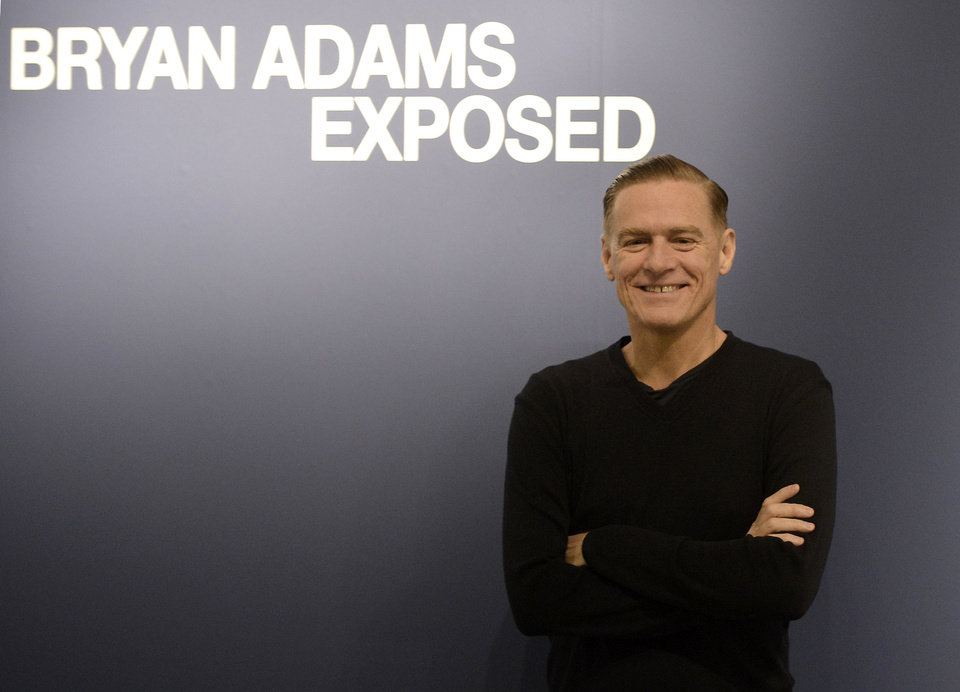 "Canadian rock star Bryan Adams poses during the opening of his photo exhibition in Duesseldorf, Germany, Friday, Feb. 1, 2013. ""Bryan Adams: Exposed,"" an exhibit of 40 of his celebrity portraits, is on view at Oklahoma Contemporary Arts Center through May 17.  (AP Photo/Martin Meissner) <strong>Martin Meissner - AP</strong>"