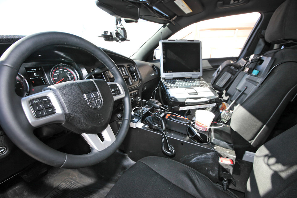 Photo - The inside of Kiowa police officer Kevin Fox's patrol car is seen Friday. Photo by David McDaniel, The Oklahoman  David McDaniel