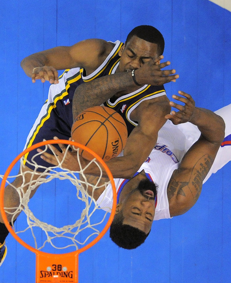 Photo - Utah Jazz guard Alec Burks, left, battles for a rebound with Los Angeles Clippers center DeAndre Jordan during the first half of an NBA basketball game, Saturday, Feb. 1, 2014, in Los Angeles. (AP Photo/Mark J. Terrill)
