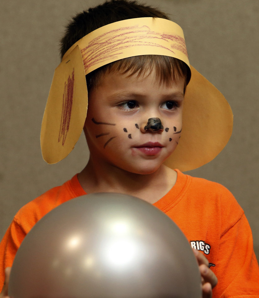 Silas Foster, 5, wears dog ears and face paint he received after voting as he participates in an election day party at the Moore Library on Tuesday, Nov. 6, 2012 in Moore , Okla.  Photo by Steve Sisney, The Oklahoman