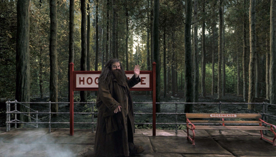 "This image released by Universal Orlando shows the character Hagrid from the ""Happy Potter"" book and film series in a scene from the Hogwarts Express attraction that will debut this summer at Universal Orlando. The attraction will allow fans to ride the Hogwarts Express train and experience the British countryside just as the characters did in the book and movie series. (AP Photo/Universal Orlando)"