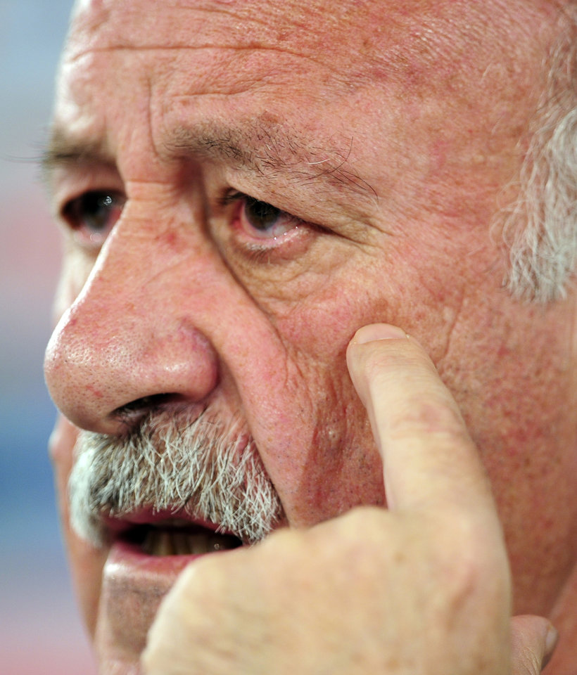 Photo - Spain's head coach Vicente del Bosque gestures during a press conference at the Atletico Paranaense training center in Curitiba, Brazil, Friday, June 20, 2014. Spain will play in group B of the Brazil 2014 World Cup. (AP Photo/Manu Fernandez)