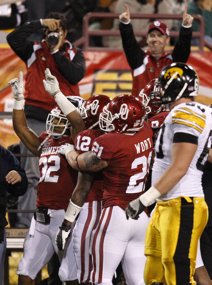 Photo - Oklahoma's Jamell Fleming (32) celebrates after an interception during the Insight Bowl college football game between the University of Oklahoma (OU) Sooners and the Iowa Hawkeyes at Sun Devil Stadium in Tempe, Ariz., Friday, Dec. 30, 2011. Photo by Bryan Terry, The Oklahoman