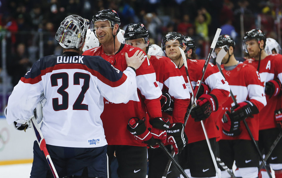 Photo - USA goaltender Jonathan Quick greets Canada forward Jeff Carter after Canada beat the USA 1-0 in a men's semifinal ice hockey game at the 2014 Winter Olympics, Friday, Feb. 21, 2014, in Sochi, Russia. (AP Photo/Petr David Josek)