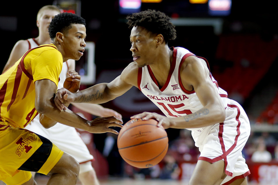 Photo - Oklahoma's Alondes Williams (15) goes past Iowa State's Rasir Bolton (45) during an NCAA basketball game between the University of Oklahoma Sooners (OU) and the Iowa State Cyclones at the Lloyd Noble Center in Norman, Okla., Wednesday, Feb. 12, 2020. [Bryan Terry/The Oklahoman]