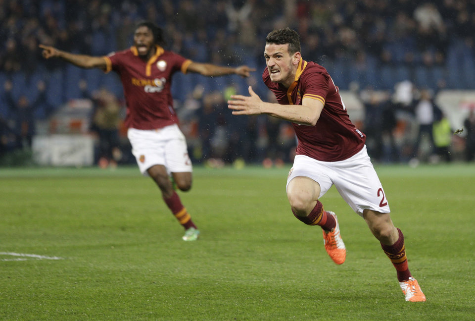 Photo - AS Roma midfielder Alessandro Florenzi, right, celebrates after he scored during a Serie A soccer match between AS Roma and Torino, at Rome's Olympic Stadium, Tuesday, March 25, 2014. (AP Photo/Andrew Medichini)
