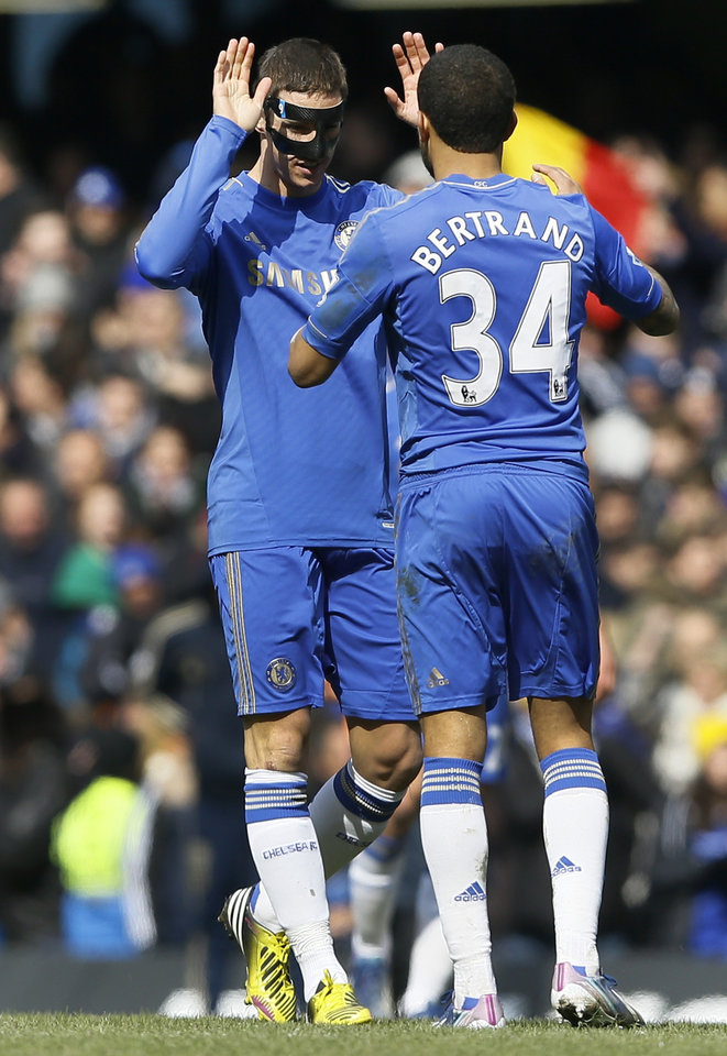 Chelsea's players Fernando Torres, left, and Ryan Bertrand celebrate after beating Manchester United 1-0 in the English FA Cup quarterfinal replay soccer match between Chelsea and Manchester United at Stamford Bridge Stadium in London, Monday, April 1, 2013. (AP Photo/Kirsty Wigglesworth)