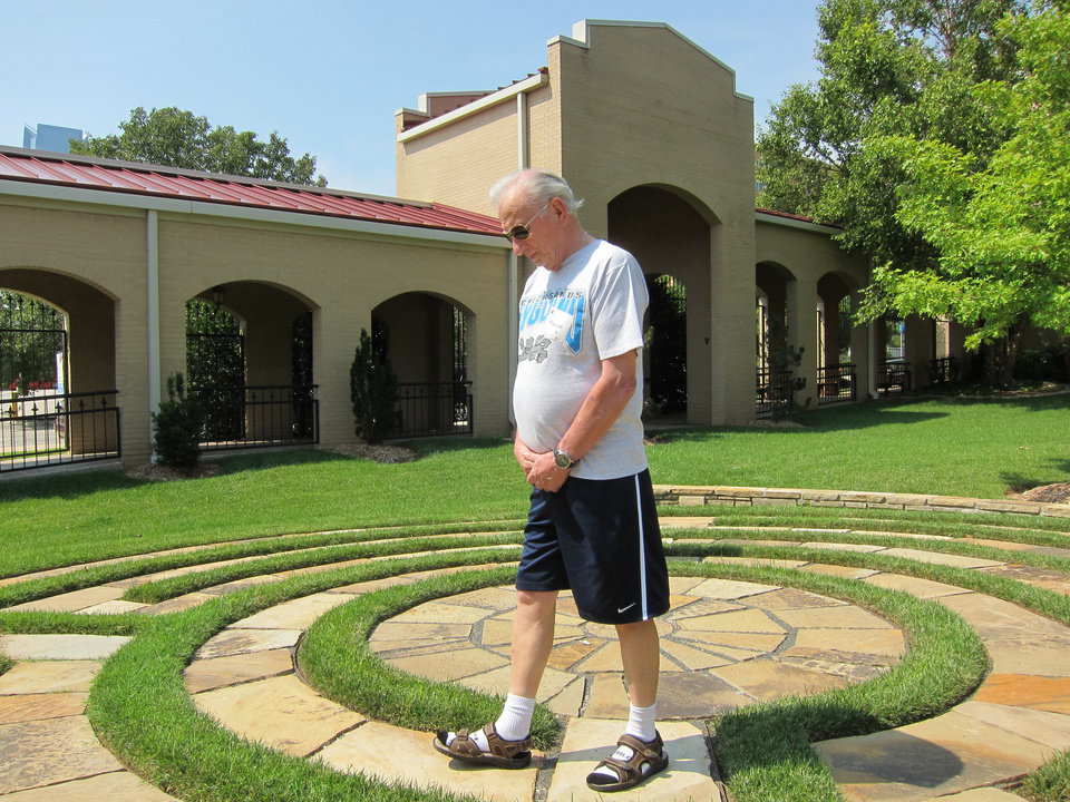 Photo - Malcolm May, of Bethany, walks the four-circuit labyrinth in the east garden of St. Paul's Episcopal Cathedral during