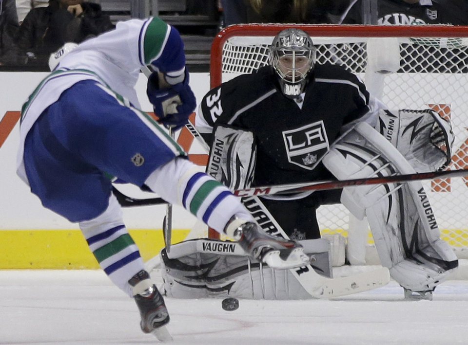 Los Angeles Kings goalie Jonathan Quick, blocks a shot by Vancouver Canucks left wing Chris Higgins during the second period of an NHL Hockey game in Los Angeles, Monday, Jan. 28, 2013. (AP Photo/Chris Carlson)
