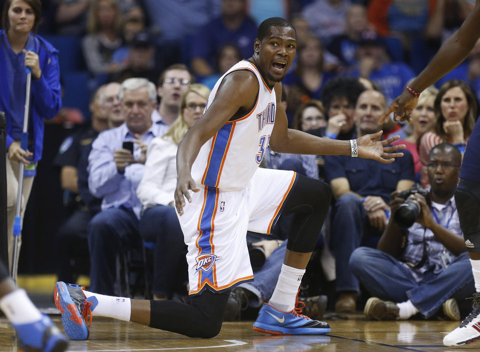 Photo - Oklahoma City Thunder forward Kevin Durant gestures to an official during the first quarter of an NBA basketball preseason game against the New Orleans Pelicans in Tulsa, Okla., Thursday, Oct. 17, 2013. (AP Photo/Sue Ogrocki) ORG XMIT: OKSO111