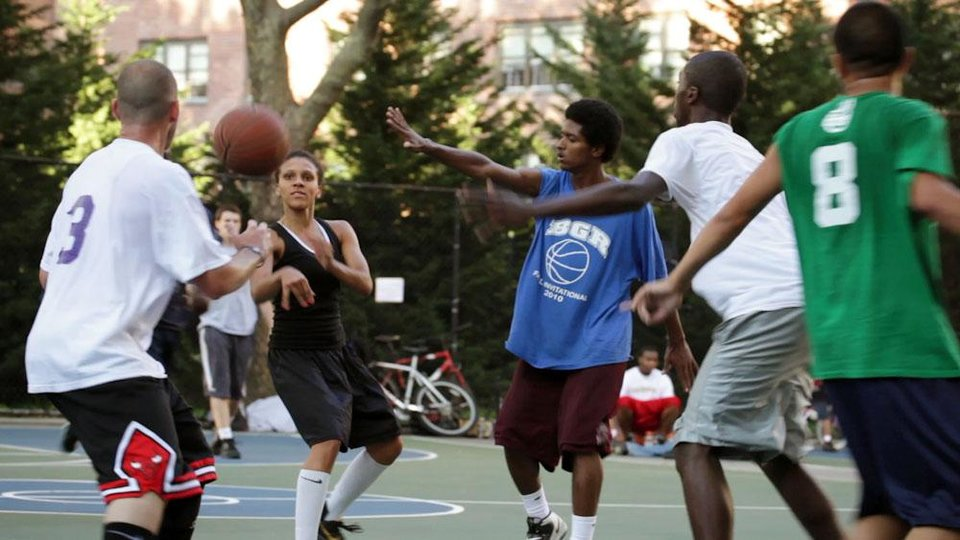 "This film publicity image released by Doin' It In The Park, LLC shows female basketball player Niki Avery, second left, playing basketball in the Spanish Harlem section of New York during filming of the documentary ""Doin' It In The Park.� (AP Photo/Doin' It In The Park, LLC)"