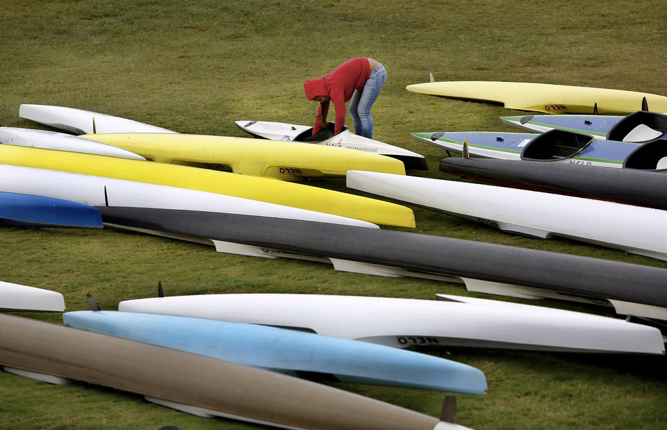 Photo - A member of the Washington Huskies team makes adjustments to the seats of their kayaks.  Regatta Festival on the Oklahoma River in the Boat District,  Saturday,  Sep. 29, 2012. The event ends Sunday. Photo by Jim Beckel, The Oklahoman.