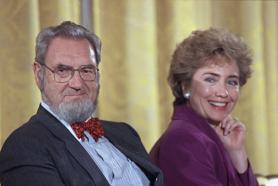 Photo - FILE - In this Oct. 1, 1993 file photo, former Surgeon Genera C. Everett Koop, left, sits with then-first lady Hillary Rodham Clinton during a meeting with more than 100 prominent doctors in the White House in Washington.  Koop, who raised the profile of the surgeon general by riveting America's attention on the then-emerging disease known as AIDS and by railing against smoking, died Monday, Feb. 25, 2013, in Hanover, N.H.  He was 96.  (AP Photo, File)