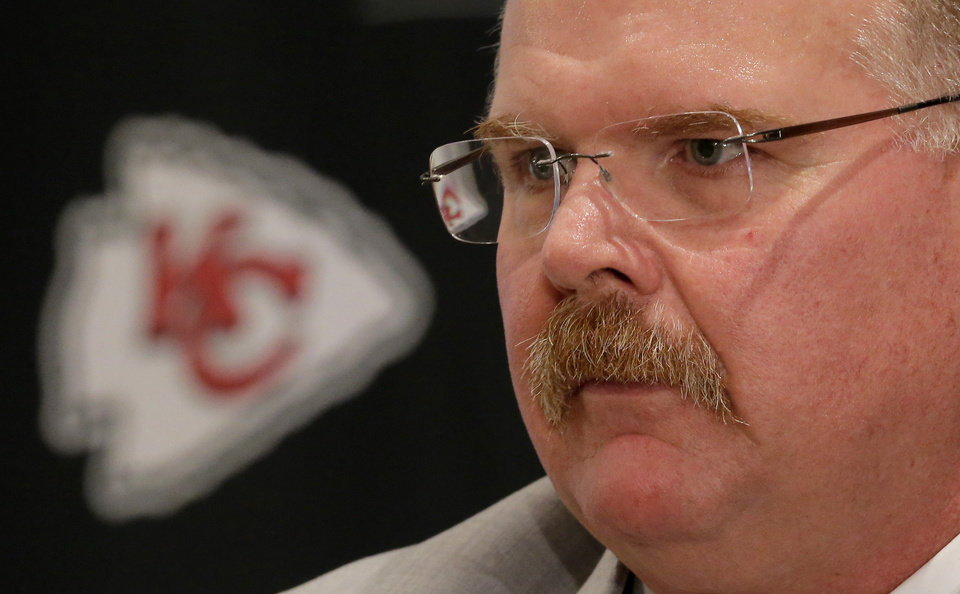 Photo - New Kansas City Chiefs NFL team head football coach Andy Reid listens to a question during a news conference at Arrowhead Stadium Monday, Jan. 7, 2013, in Kansas City, Mo. (AP Photo/Charlie Riedel)