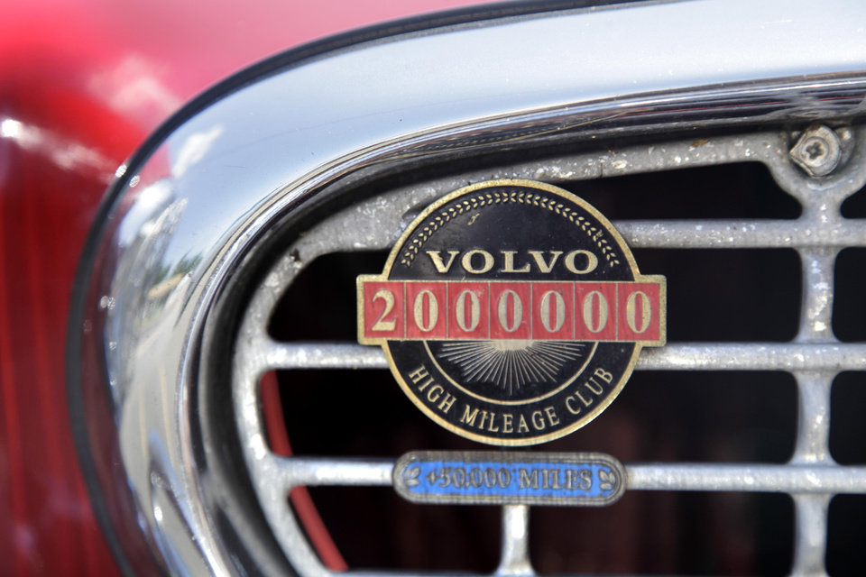 Photo -   A two million mile badge adorns Irv Gordon's Volvo P1800 in Babylon, N.Y., Monday, July 2, 2012. Gordon's car already holds the world record for the highest recorded milage on a car and he is less than 40,000 miles away from passing three million miles on the Volvo. (AP Photo/Seth Wenig)