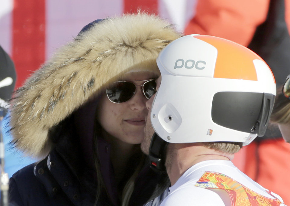 Photo - United States' Bode Miller kisses his wife, Morgan, after a men's downhill training run for the Sochi 2014 Winter Olympics, Saturday, Feb. 8, 2014, in Krasnaya Polyana, Russia. (AP Photo/Gero Breloer)