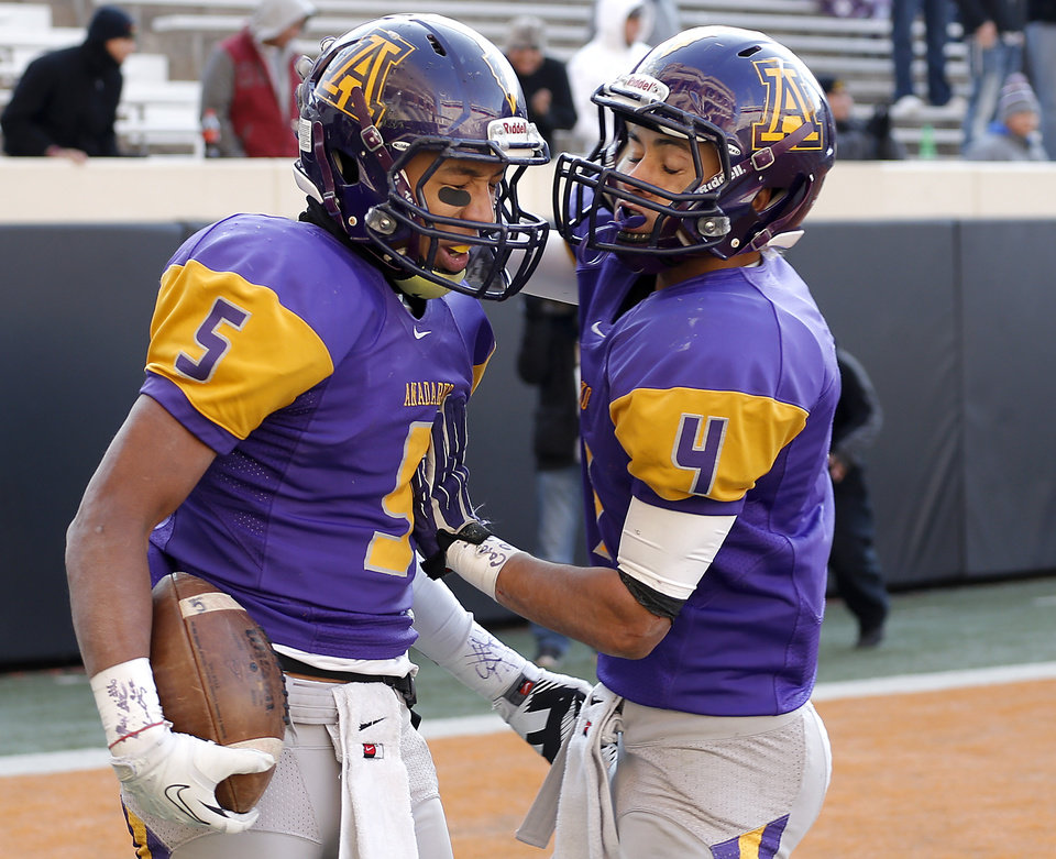 Photo - Anadarko's RJ Sink (5) and Brayden Alexander (4) celebrate a touchdown during the Class 4A State Football Championship game between Anadarko and Poteau at Boone Pickens Stadium in Stillwater, Okla. Photo by Sarah Phipps, The Oklahoman