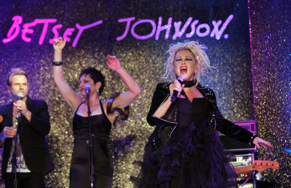 Photo -   Singer Cyndi Lauper performs before the Betsey Johnson Spring 2013 collection show during Fashion Week, Tuesday, Sept. 11, 2012, in New York. (AP Photo/Jason DeCrow)