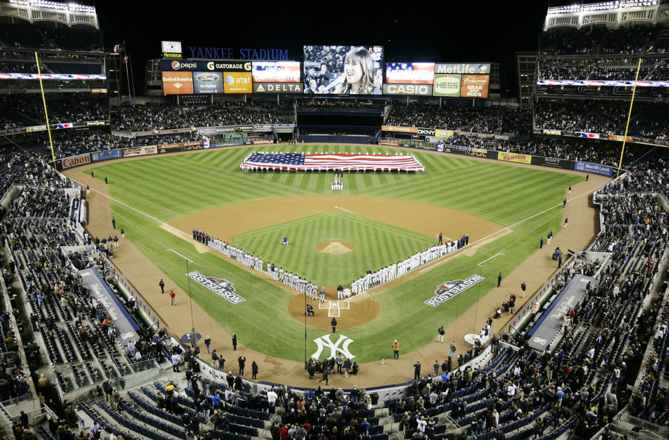 Photo -   Jenna Ushkowitz sings the National Anthem before the start of Game 1 of the American League championship series between the New York Yankees and Detroit Tigers Sunday, Oct. 14, 2012, in New York. (AP Photo/Peter Morgan)
