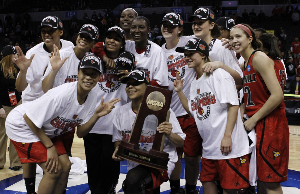 Louisville\'s team poses for a photo after defeating Tennessee during the Oklahoma City regional final game in the women\'s NCAA college basketball tournament in Oklahoma City, Tuesday, April 2, 2013. Louisville own 86-78. (AP Photo/Alonzo Adams)